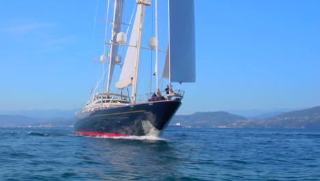 A-traveling-shot-around-the-bow-of-a-large-sailboat-at-sea