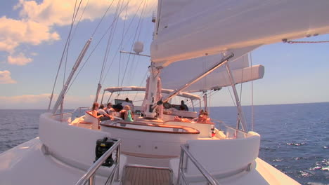 A-sailboat-sails-across-the-ocean-and-we-look-up-to-the-mast-and-sail