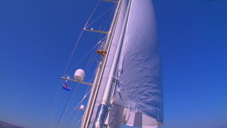 A-pan-across-a-sailboat-in-the-Mediterranean-as-we-tilt-up-to-view-the-white-sails-1