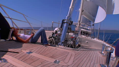 A-sailboats-deck-as-it-moves-across-the-Mediterranean-as-we-tilt-up-to-the-sail