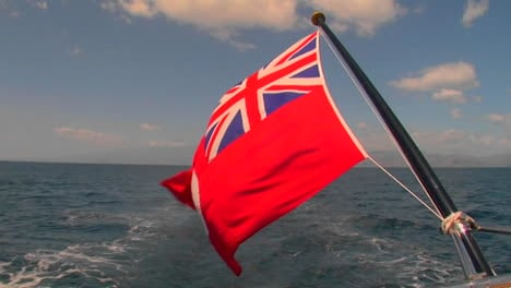 The-flag-of-the-Cayman-Islands-flies-behind-a-ship-on-the-high-seas