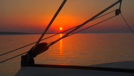 A-beautiful-sunset-seen-through-the-rigging-of-a-sailboat
