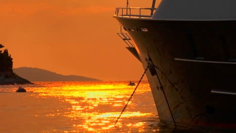 Croatian-sunset-on-the-water-ship-bow-in-foreground