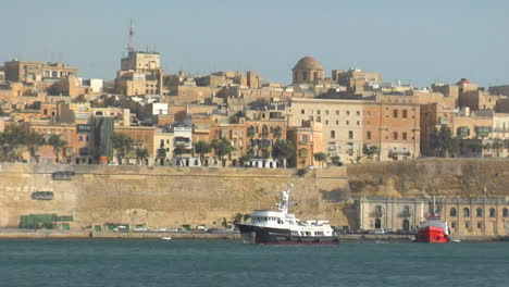 View-of-Maltas-old-city-scape-with-a-ship-coming-into-the-harbor