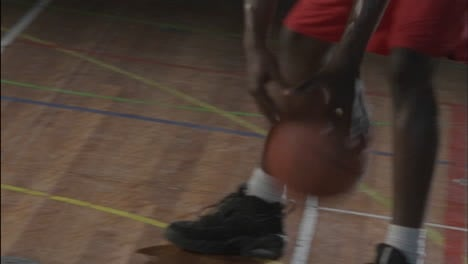 Three-men-passing-a-basketball-back-and-forth-around-their-knees