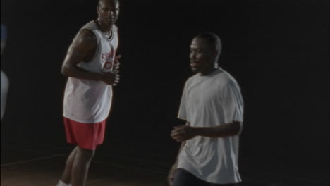 Men-passing-a-basketball-around-on-a-court