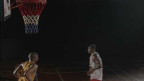 Three-men-play-basketball-on-an-indoor-court-6
