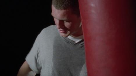 A-man-hits-a-punching-bag