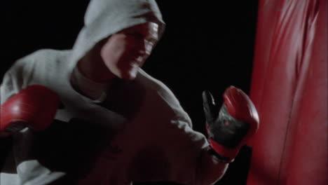 A-man-hits-a-punching-bag-7