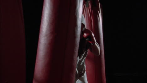 A-man-dances-around-while-punching-a-heavy-bag