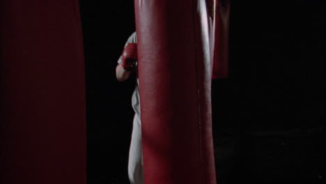 A-boxer-practices-by-hitting-punching-bags