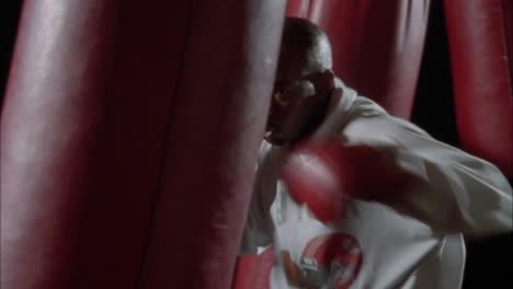 A-man-hits-a-punching-bag-9