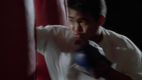 A-man-works-out-vigorously-on-a-punching-bag