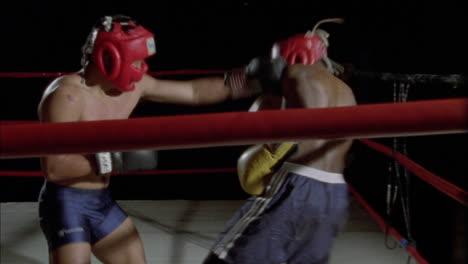 Two-boxers-fighting-in-a-boxing-ring-1