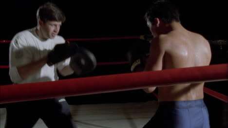 Two-boxers-fighting-in-a-boxing-ring-2