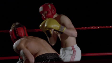 Two-boxers-fight-in-a-boxing-ring
