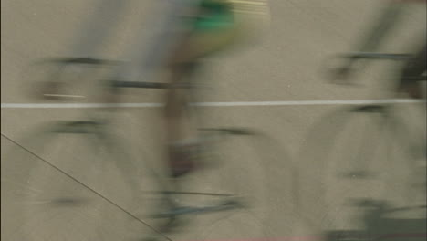 Bicycle-riders-pass-by-in-a-blur