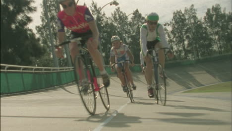 A-group-of-cyclists-ride-around-a-track-1