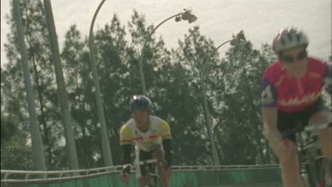 Bicyclists-compete-on-a-circuit-track-1