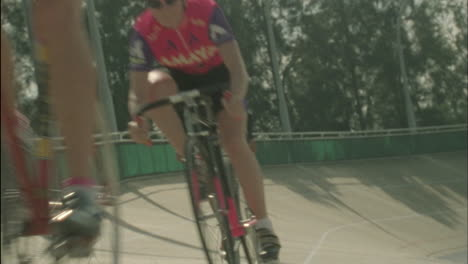 A-group-of-cyclists-ride-around-a-curved-track