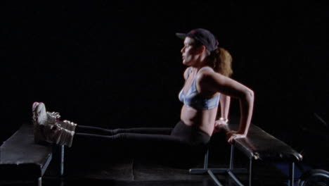 A-woman-doing-triceps-dips-on-a-bench