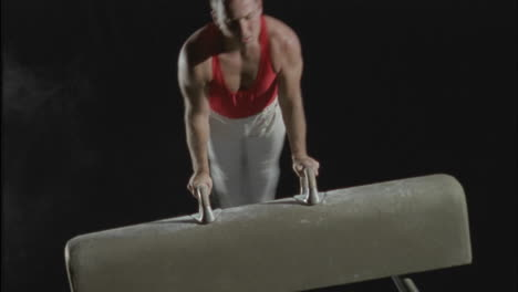 A-gymnast-performs-flairs-on-the-pommel-horse