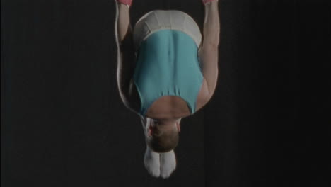 A-man-does-a-gymnastics-workout-on-rings