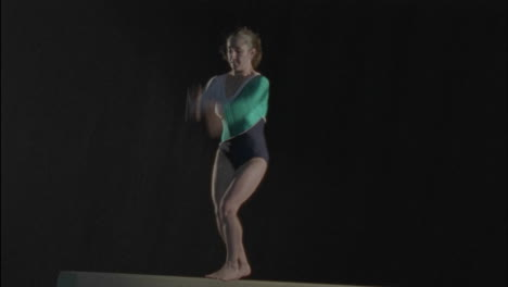 A-young-gymnast-performs-a-routine-on-a-bar