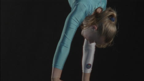 Young-gymnast-performing-on-a-balance-beam