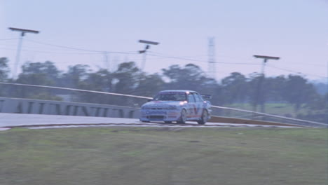 A-racing-car-drives-on-a-circuit-track