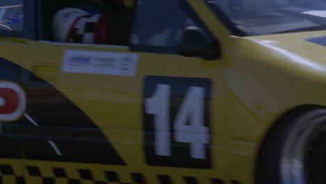 A-yellow-racing-car-drives-around-a-race-track