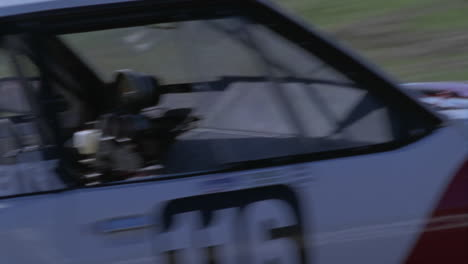 A-race-car-speeds-around-a-corner-on-a-track