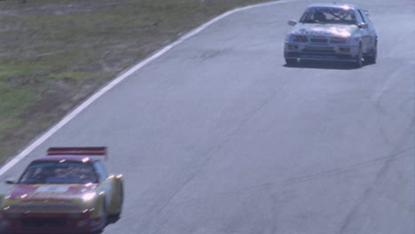 Racing-cars-competing-on-a-circuit-track-1