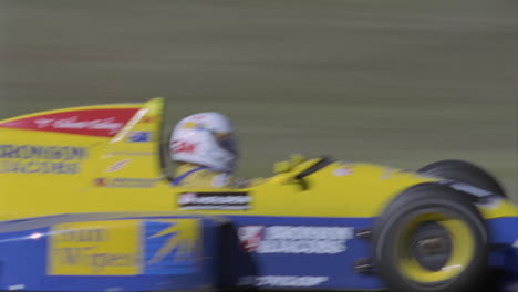 A-racing-car-reaches-the-finish-line-as-an-official-observes