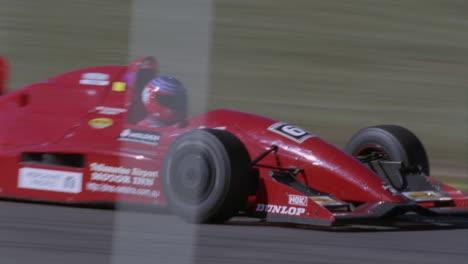 A-race-car-speeds-down-a-track