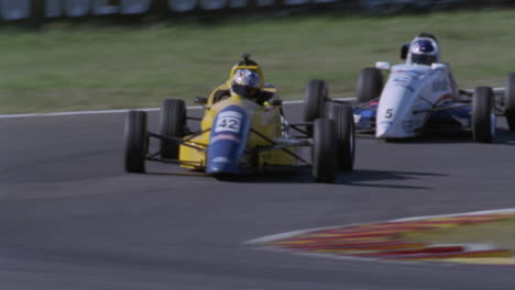 Formula-cars-race-on-a-circuit-track-1