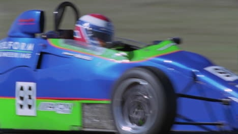 A-race-car-driver-accelerates-out-of-a-sharp-turn