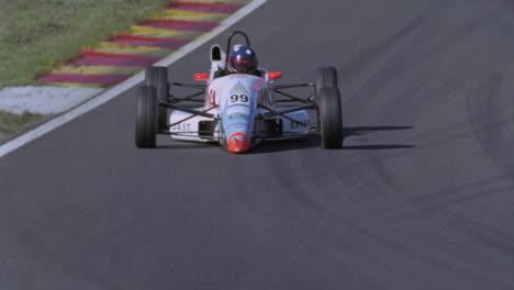 A-racing-car-drives-around-a-racetrack