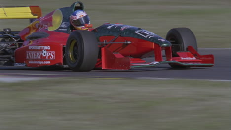 Racing-cars-speed-around-a-track