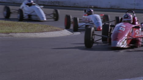 Cars-race-around-a-sharp-turn