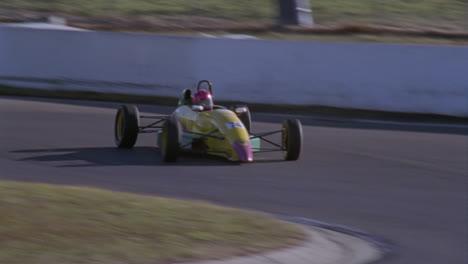 Three-racing-cars-race-around-a-track-1