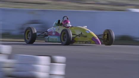A-race-car-heads-into-a-turn-on-a-race-track