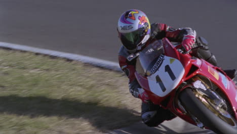 A-motorcycle-racer-leans-into-a-sharp-turn-1