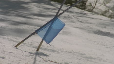 A-skier-speeds-past-a-toppled-flag