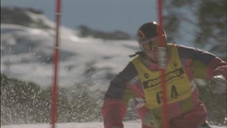 A-man-skies-around-a-slalom-flag