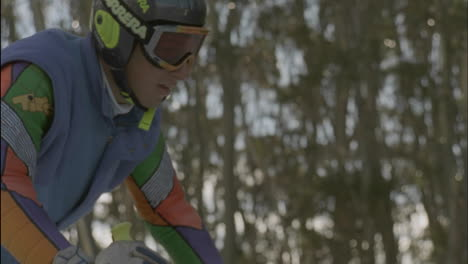 A-skier-prepares-to-ski-down-a-slope