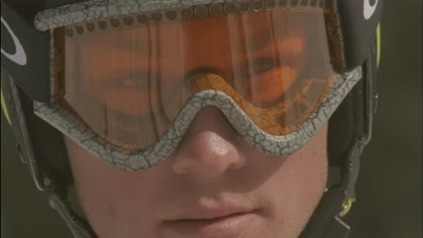 A-child-looks-through-goggles-in-a-ski-helmet