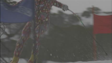 A-person-skies-down-hill-through-a-slalom-course