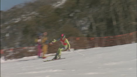 A-skier-skis-downhill-as-people-watch