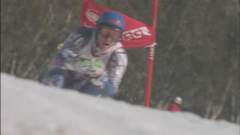 A-person-skies-down-hill-through-a-slalom-course-1